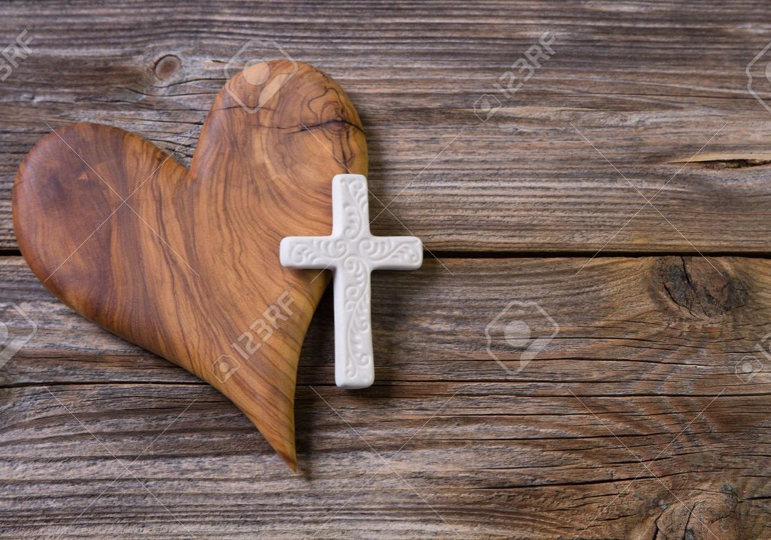 28339423-olive-heart-and-white-cross-for-an-obituary-notice-
