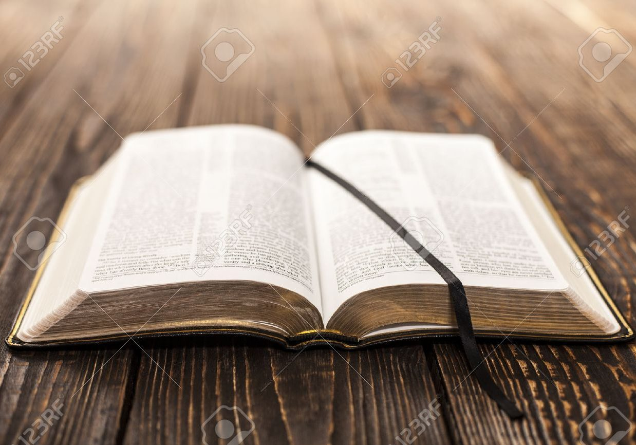 35811737-open-book-on-wood-background