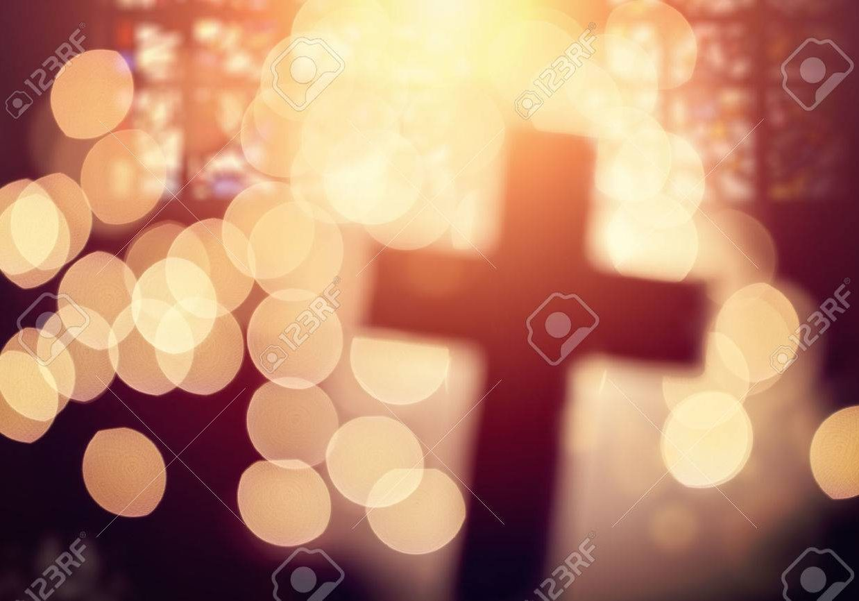 54427916-abstract-defocussed-cross-silhouette-in-church-interior-against-stained-glass-window-concept-for-rel